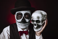 Man with mexican calaveras makeup and skull Royalty Free Stock Photos