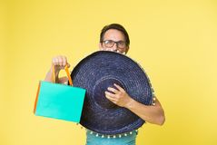 Man with mexican sombrero. Mexican man with sombrero hat and shopping bag. Enjoy shopping trip to mexico. Look what I. Got stock photo
