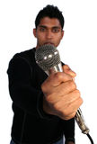 Man and Mic. A Man holding a Mic royalty free stock photography