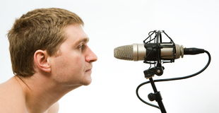 Man with microphone. Man with grey studio microphone Royalty Free Stock Photo