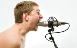 Man with microphone. Man with grey studio microphone Royalty Free Stock Photos