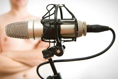 Man with microphone. Man with grey studio microphone Stock Photos