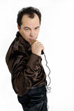 Man with microphone. Man singing with microphone in hand Stock Photography
