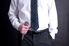 Man with microphone. Image of a man holding a microphone wearing a tie Stock Photography