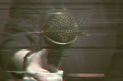 Man with microphone, digital glitch effect. Royalty Free Stock Photos