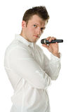 Man with microphone in hands Royalty Free Stock Photo