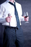 Man with microphone and wine. Image of a man holding a microphone and a drink Stock Photos