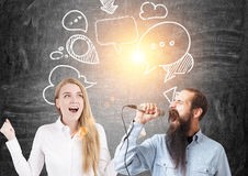 Man with a microphone, woman, speech bubbles Royalty Free Stock Photography