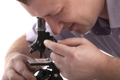 Man with a microscope. Portrait of a man with a microscope Stock Image