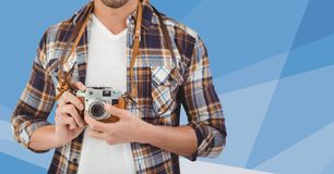Man mid section with camera against blue  mesh Royalty Free Stock Image
