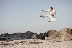 Man in a midair action image Stock Photos