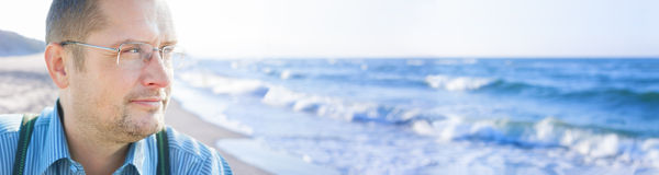 Man middle age outside sea background panorama Royalty Free Stock Image