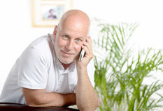 A man of middle age on phone Stock Images