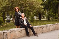 A man and a middle-aged woman in a city park royalty free stock photo