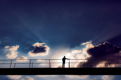 Man In The Middle Of A Bridge Royalty Free Stock Photography