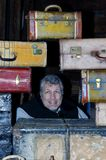 Man in Middle of Suitcases Royalty Free Stock Photos
