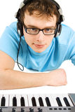 Man with midi keyboard and headphones isolated Stock Photos