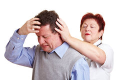 Man with migraine seeing a doctor. For an examination Royalty Free Stock Photo
