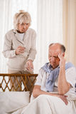 Man with migraine taking painkiller Stock Photo