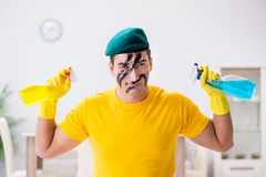 The man in military style cleaning the house Royalty Free Stock Photo