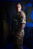 Man with military uniform. Man wearing military uniform in studio royalty free stock photos