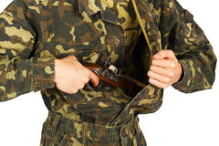 Man in military uniform gets a gun Stock Photo