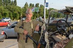 A man in a military uniform of the Second world war Mamayev Kurgan in Volgograd. Stock Images
