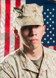 Man in military uniform on USA flag background Stock Photography