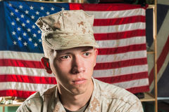 Man in military uniform on USA flag background Stock Photos