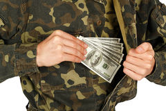 Man in military uniforms pulls money out of his jacket Stock Photos