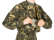 Man in military uniforms pulls money out of his jacket Stock Photo