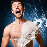 Man in the milk. Emotional man laughs. splashes of milk on his body royalty free stock photos