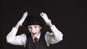 Man MIME with a sour face on black background stock video