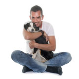 Man and miniature australian shepherd. In front of white background stock images