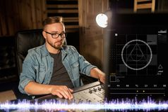 Man at mixing console in music recording studio Royalty Free Stock Photography