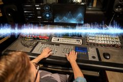 Man at mixing console in music recording studio Royalty Free Stock Image