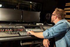 Man at mixing console in music recording studio Stock Image