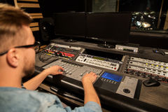Man at mixing console in music recording studio Stock Photography