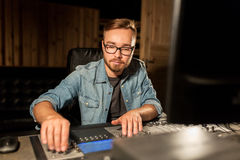 Man at mixing console in music recording studio Royalty Free Stock Photo