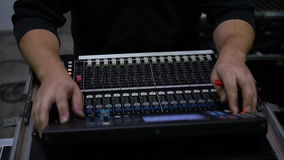 Man at a mixing desk stock video footage