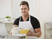 Man Mixing Ingredients in Kitchen Stock Photography