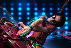 Man mixing records with colorful lights Royalty Free Stock Photography