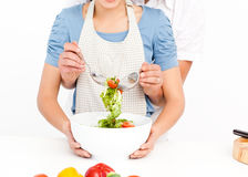 Man mixing a salad with his girlfriend Stock Photo