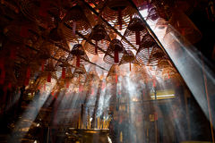 MAN MO TEMPLE. HONG KONG.. Smoke form the incense coils burning in Man Mo Temple. Hong Kong Stock Image