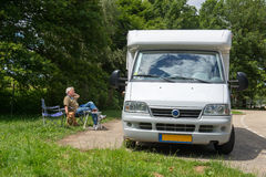 Man with mobil home Stock Photo