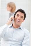 Man on mobile. Happy businessman enjoy a conversation at mobile phone Stock Photography
