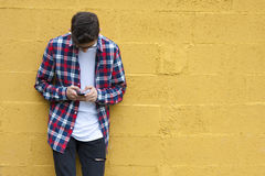 Man with mobile. Boy casual style with smartphone Royalty Free Stock Photos