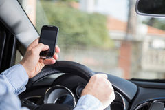 Man with mobile and driving Royalty Free Stock Images
