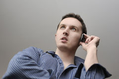 Man with mobile phone. In hand Royalty Free Stock Image