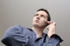 Man with mobile phone. In hand Stock Photos